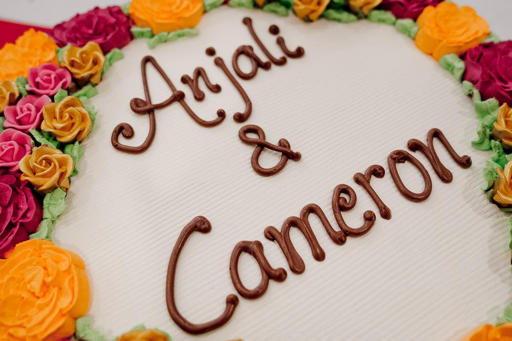 Floral Peronalised Cake Indian Wedding UK Laura May Photography