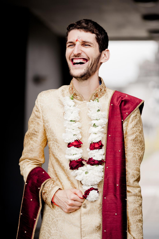 Gold Red Sherwani Groom Indian Wedding UK Laura May Photography