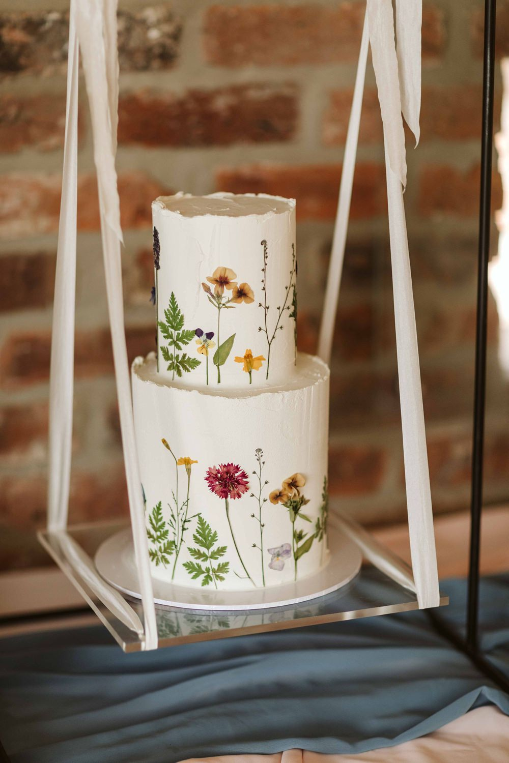 Painted Cake Flowers Floral Swing Table Oakwood at Ryther Wedding Freya Raby