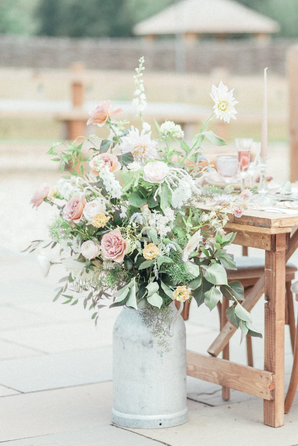 Milk Churn Flowers Table Decor Pink Rose Greenery UK Destination Wedding Hannah McClune Photography