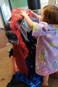 Little Fashion Designer Dressing Up Mannequin