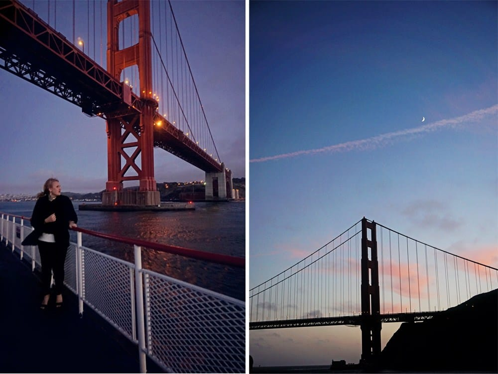 sailing under golden gate bridge at sunset