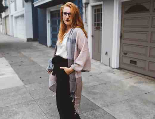 pink scarf black wide leg pants woman red hair
