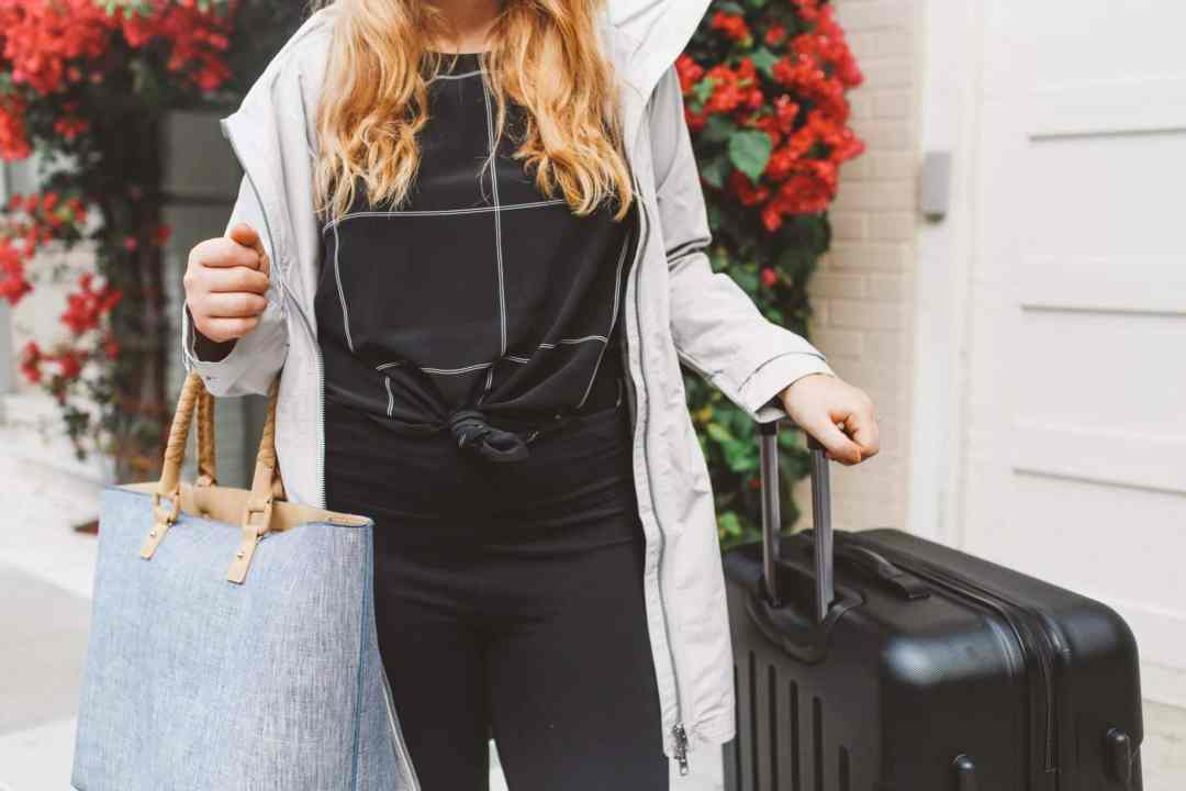 packing suitcase grey coat street leggings