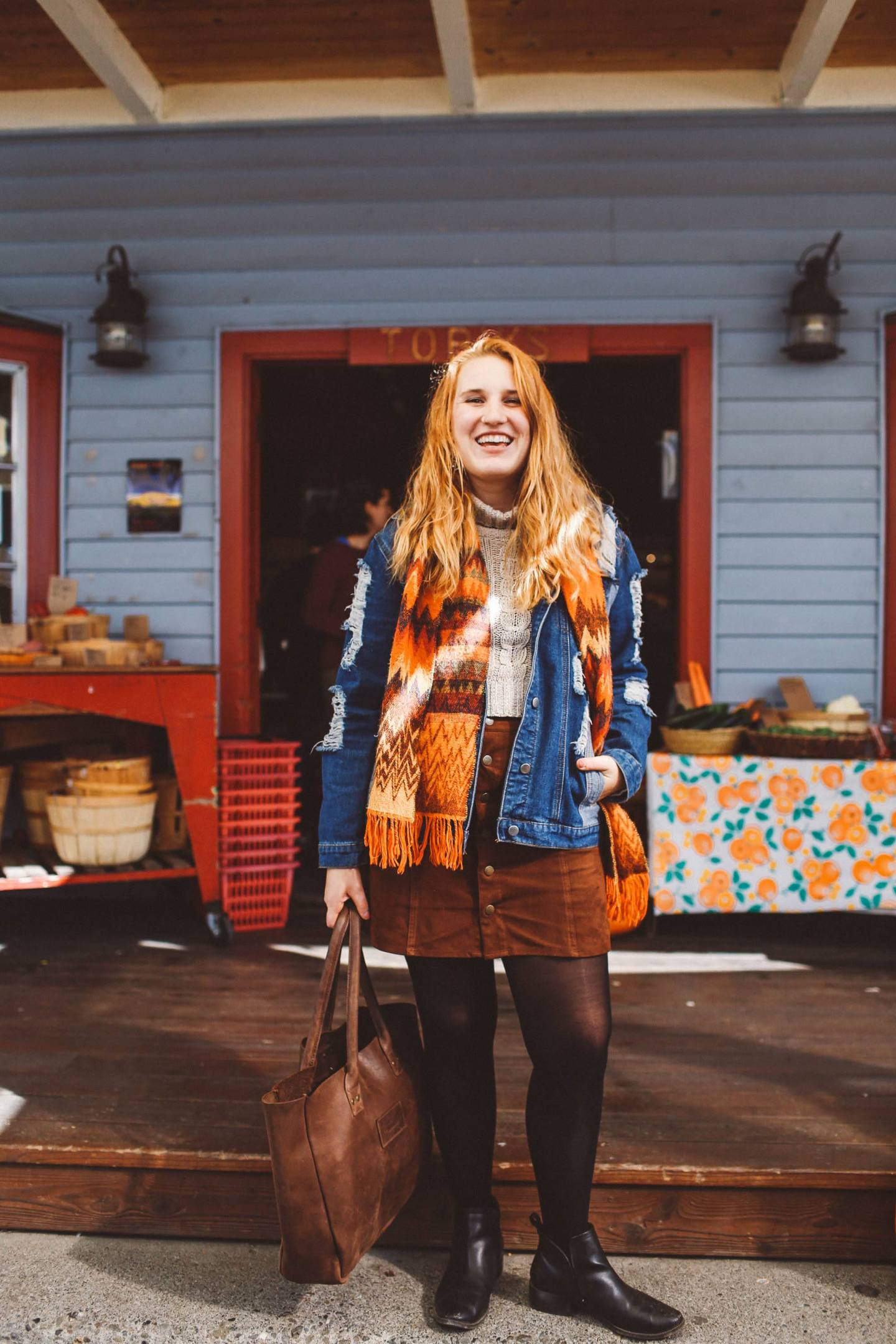 Woman orange scarf denim jacket