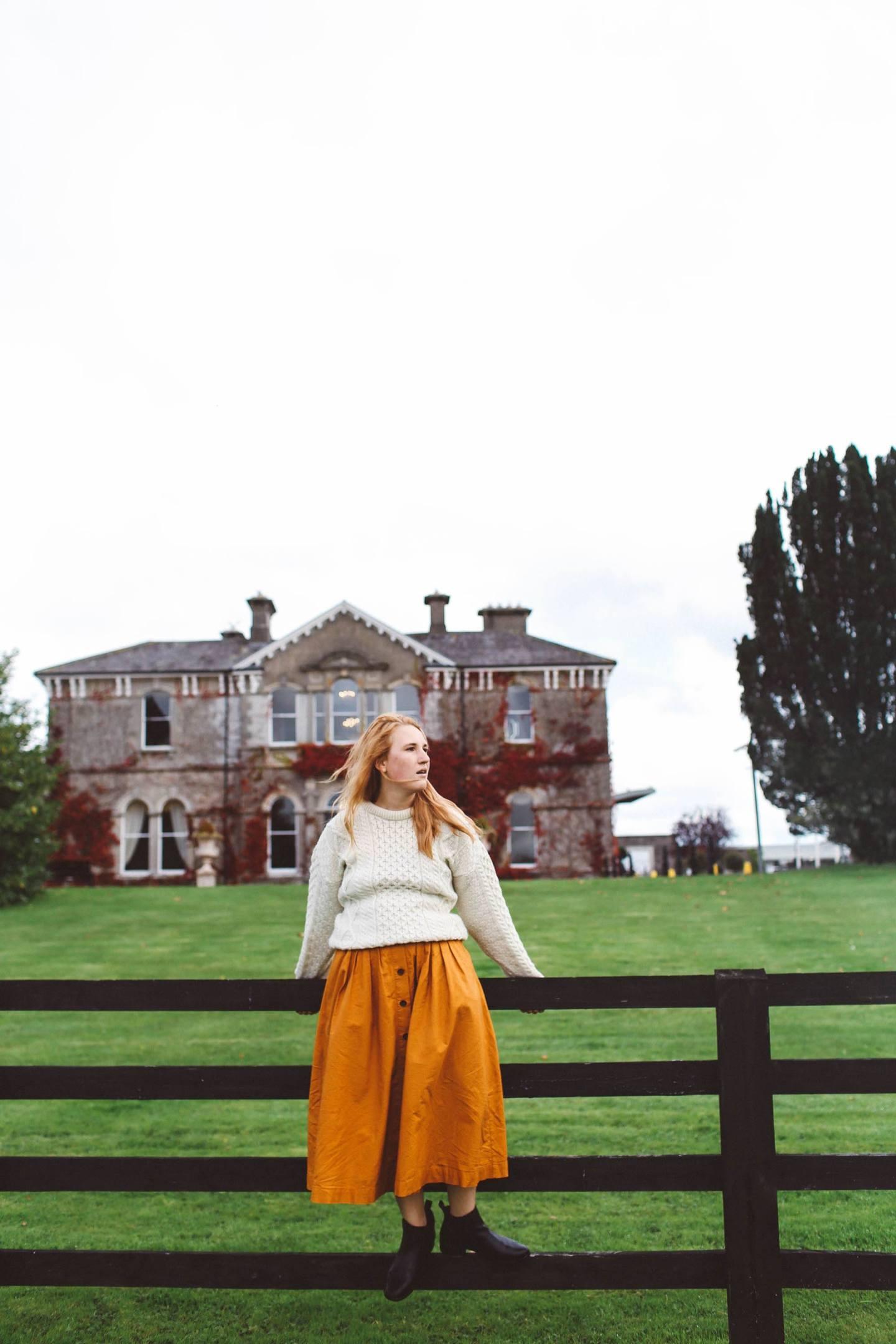 woman white sweater orange midi skirt lyrath estate