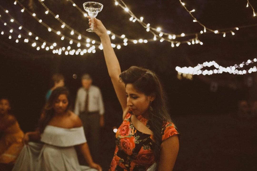 wedding dancing holding drink up