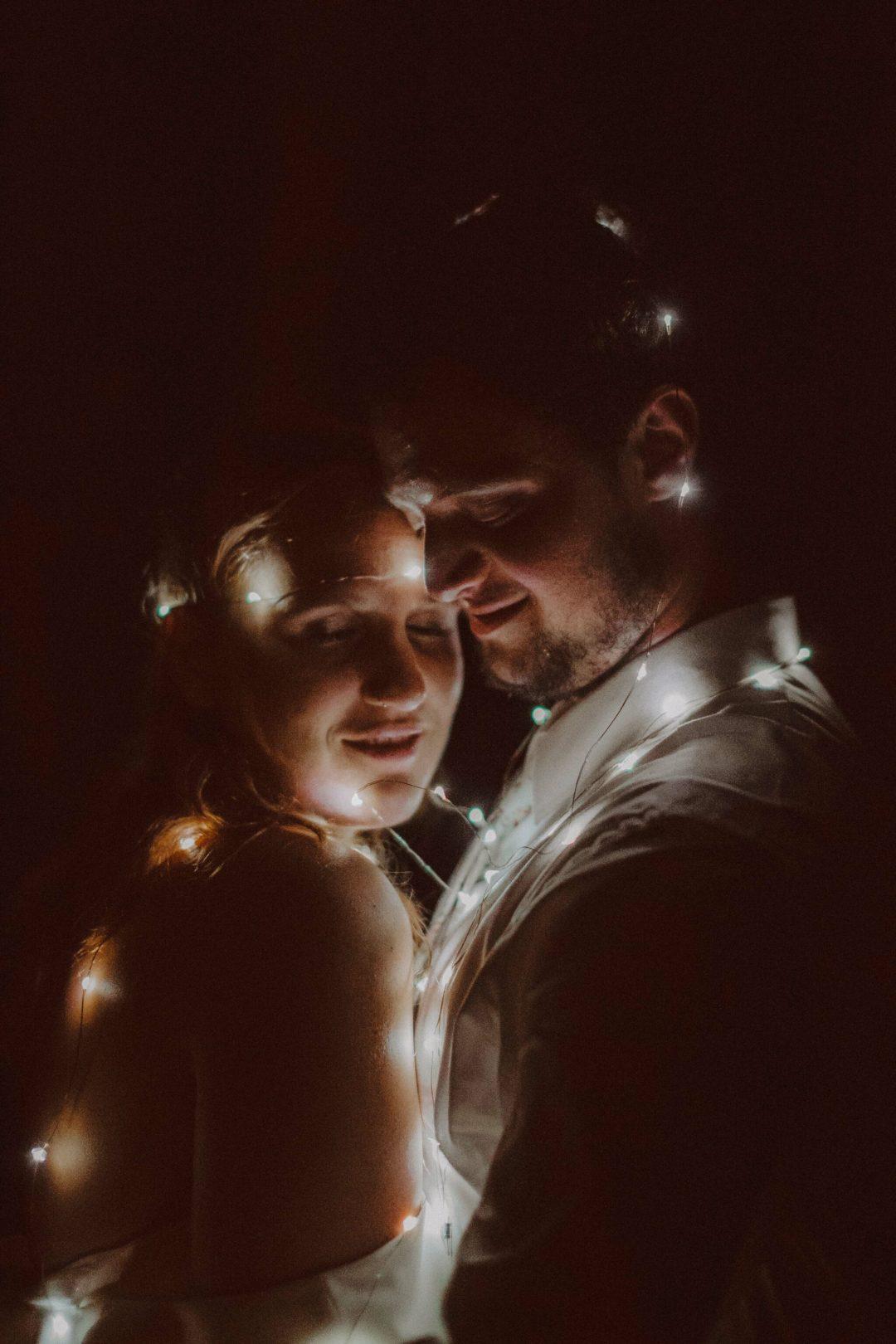 bride groom string lights portrait