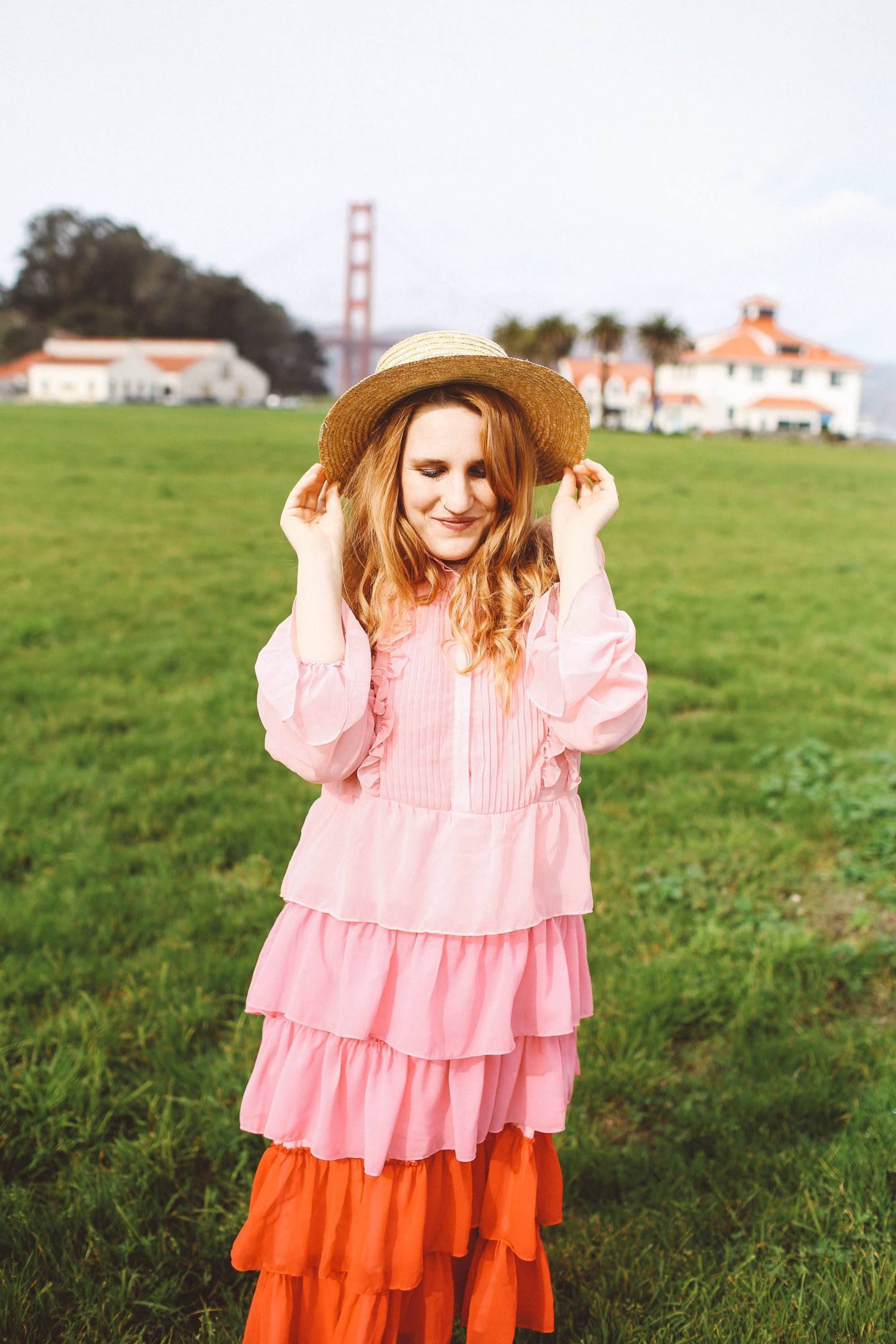 pink ruffle dress san francisco golden gate bridge straw hat