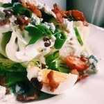 close-up of wedge salad with bacon, egg, and horseradish bleu cheese dressing