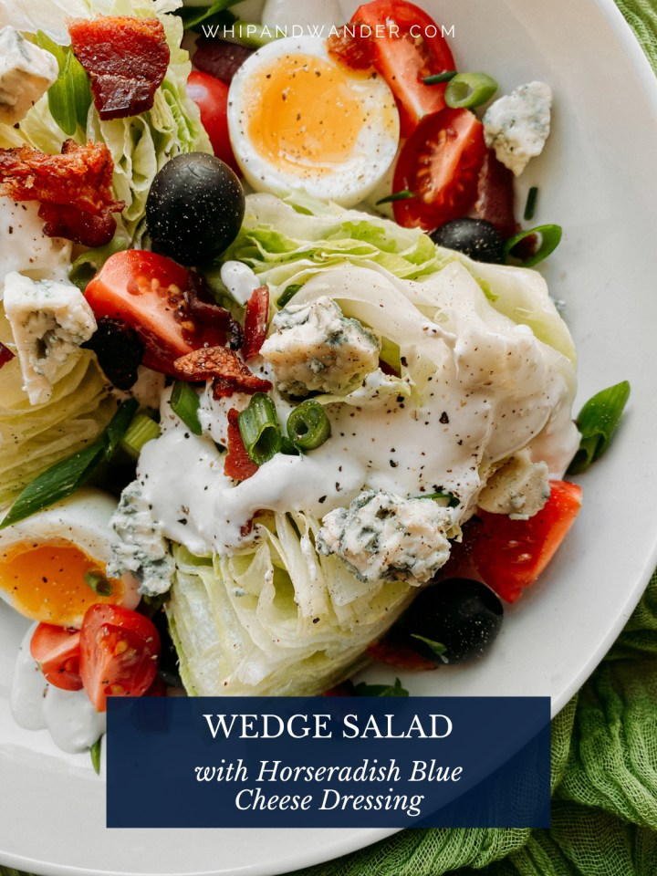 a wedge of salad with horseradish blue cheese dressing and other toppings