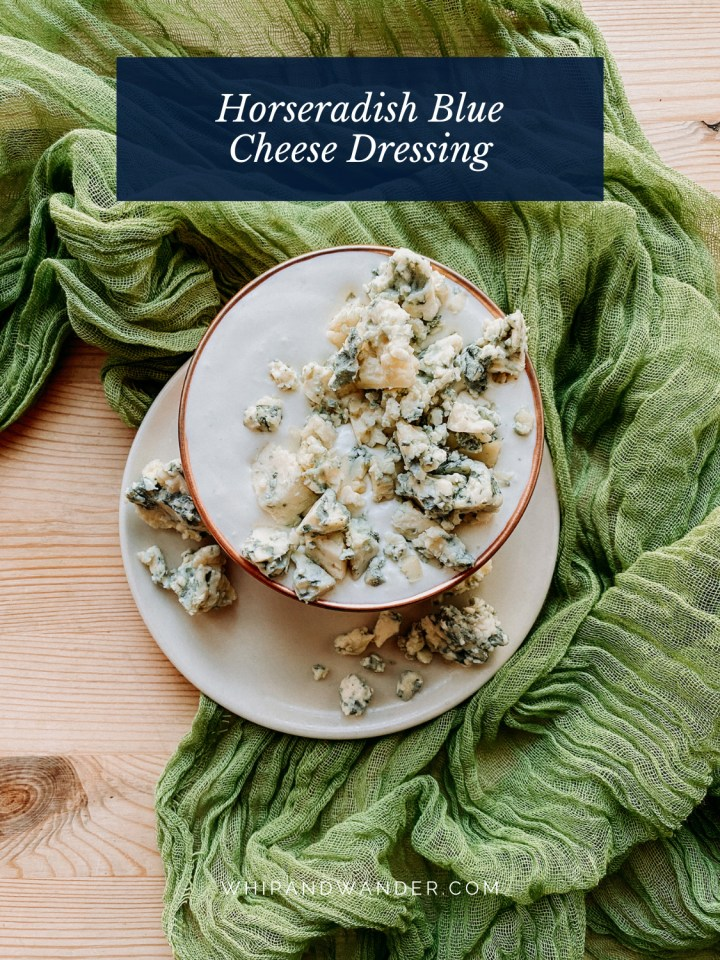 a dish filled with horseradish blue cheese dressing and crumbles of blue cheese