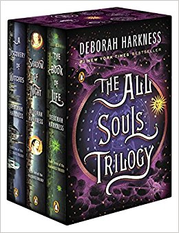 Three books lined up with the words The All Souls Trilogy on the front cover
