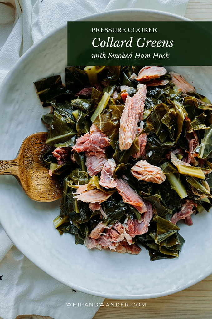 instant pot collard greens with smoked ham hock in a white dish with a wooden serving spoon resting in the collard greens