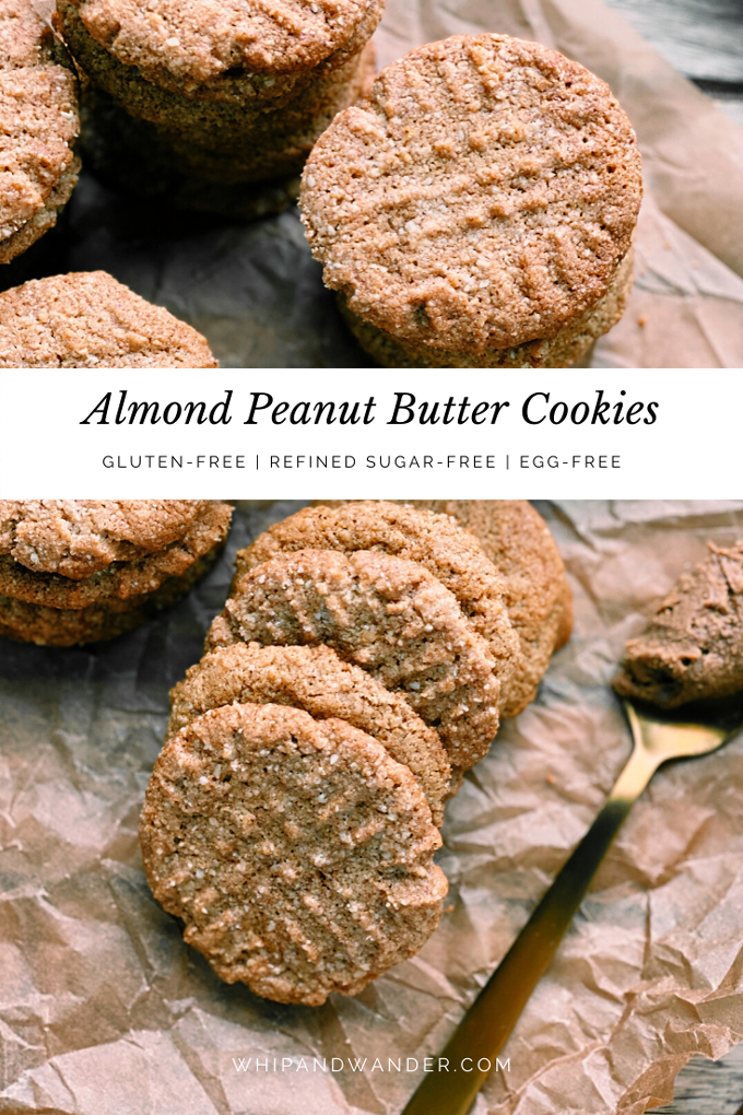 Almond Peanut Butter Cookies and a spoonful of nut butter resting nearby on brown baking paper