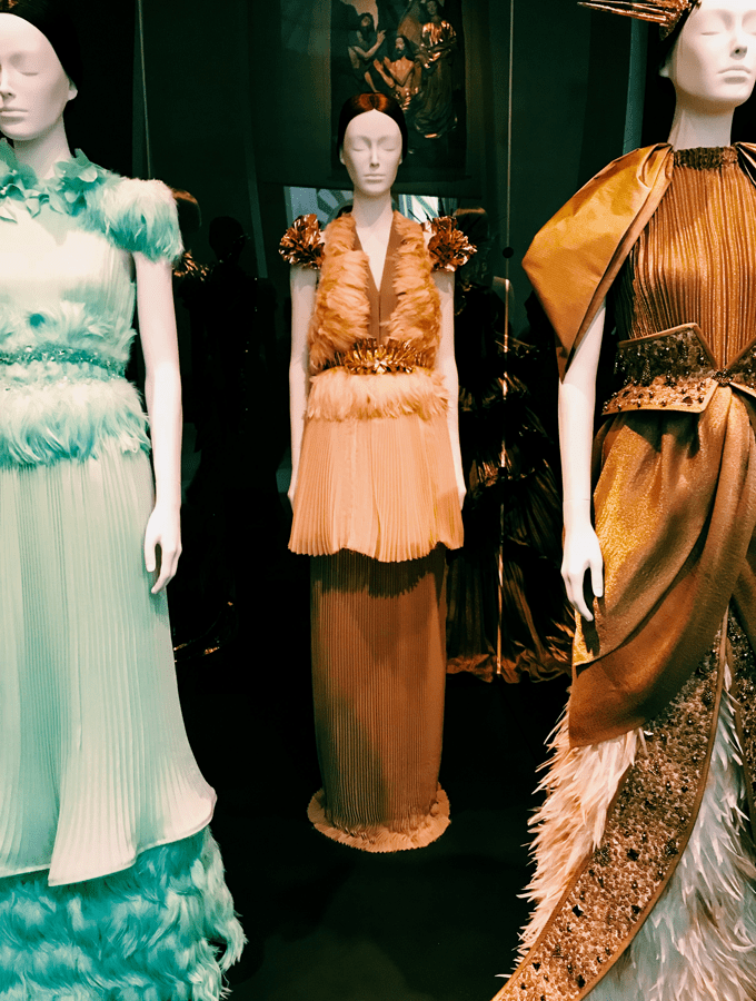 A row of mannequins in fancy gowns