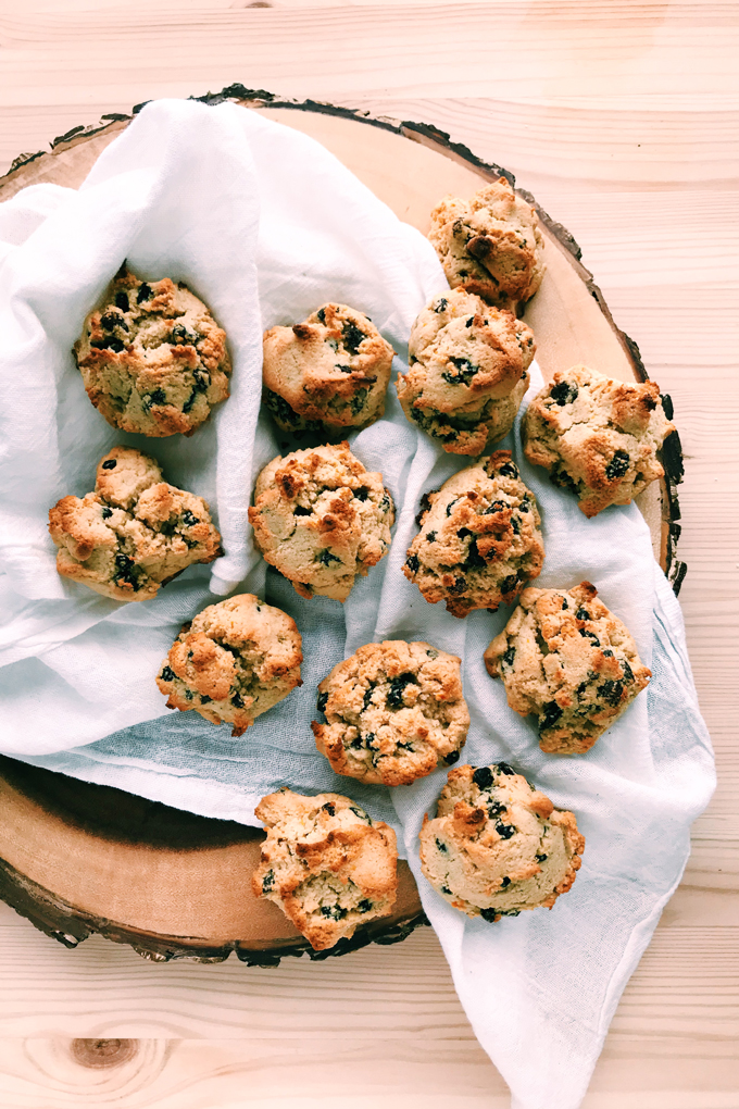 a pile of rock cakes on a white towel on a wooden board