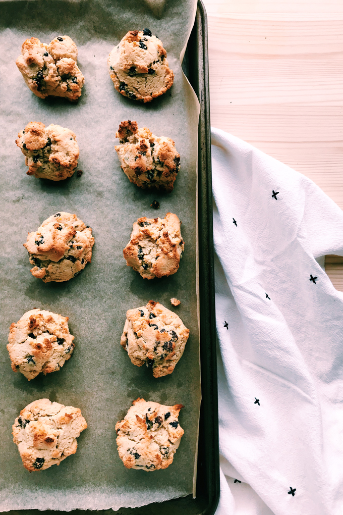 a tray of baked rock cakes next to a white and black towel