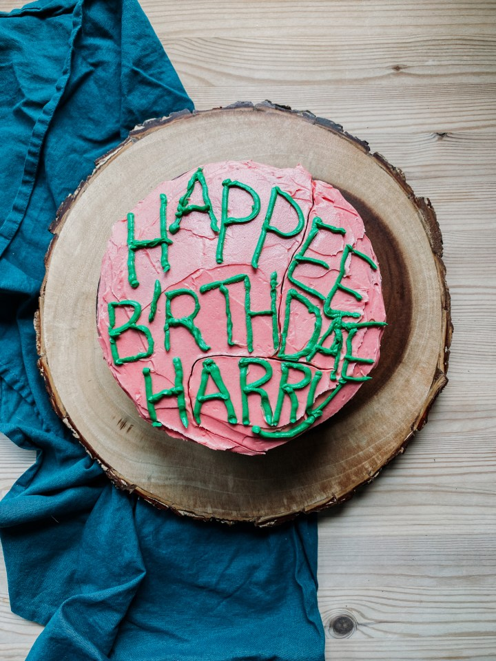 a pink and green frosted sticky chocolate birthday cake with a harry potter decorated theme