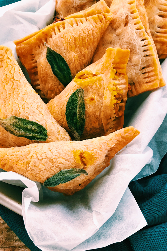 a loaf pan of gluten free pumpkin pasties with sage leaves