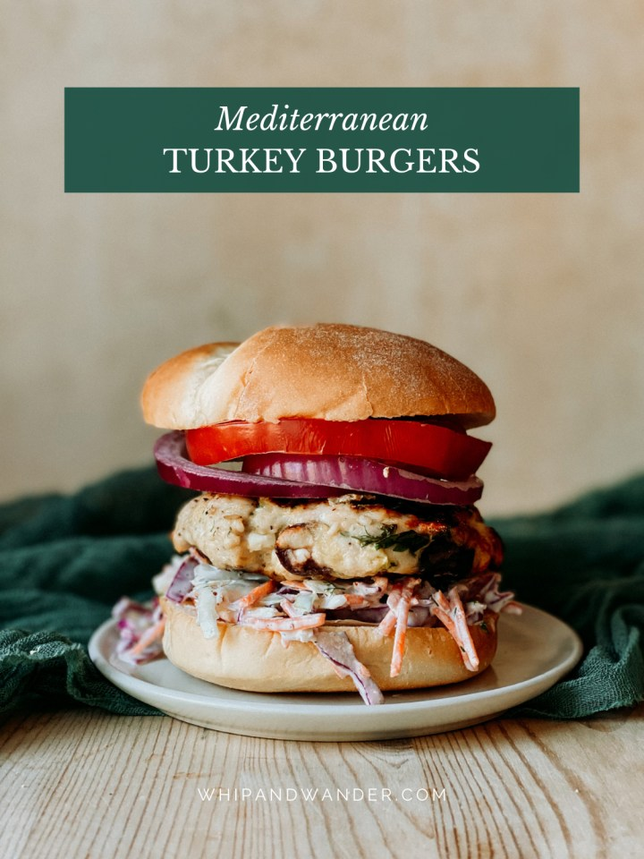 Mediterranean Turkey Burgers with slaw, tomato, and onion on a plate