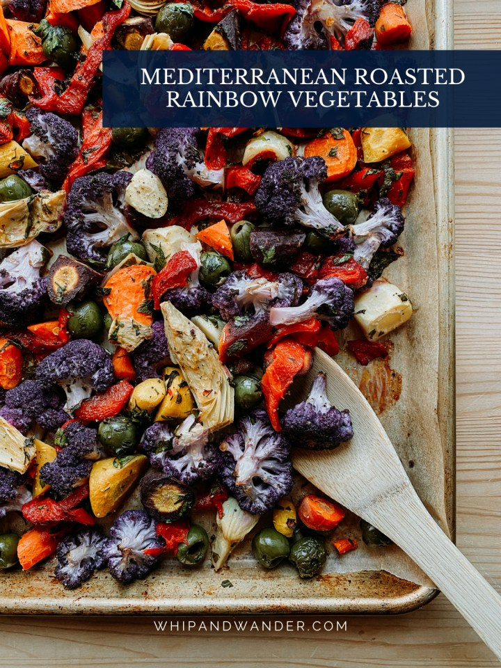 a wooden utensil scooping into a baking tray of veggies