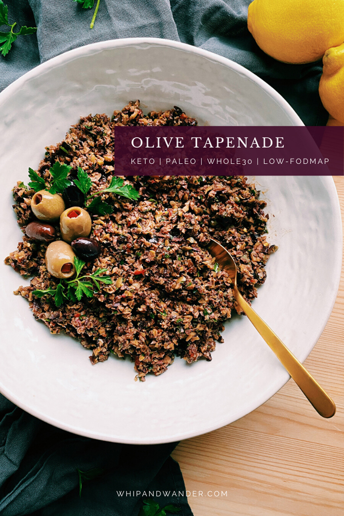 olives, Olive Tapenade, and parsley in a white dish with a gold spoon resting in it