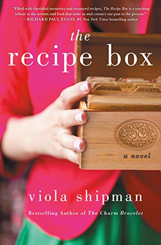 woman in pink and green holding a wooden recipe box