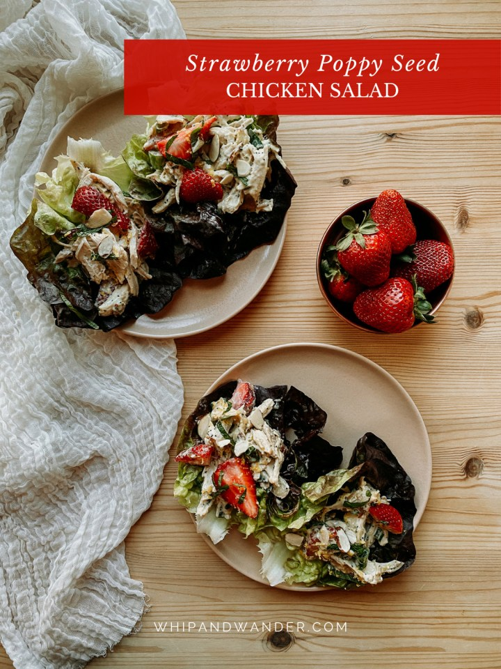 a small bowl filled with fresh strawberries next to two brown plates filled with Strawberry Poppy Seed Chicken Salad and butter lettuce cups