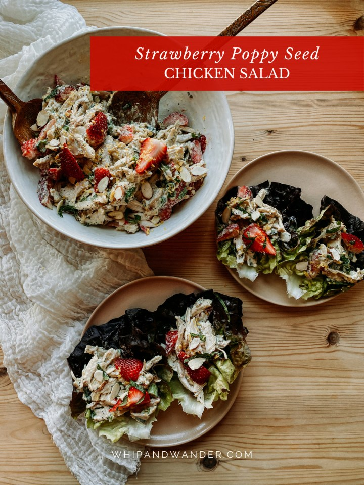 a white serving dish filled with Strawberry Poppy Seed Chicken Salad and two brown salad plates with chicken salad lettuce cups on top resting on a wooden table