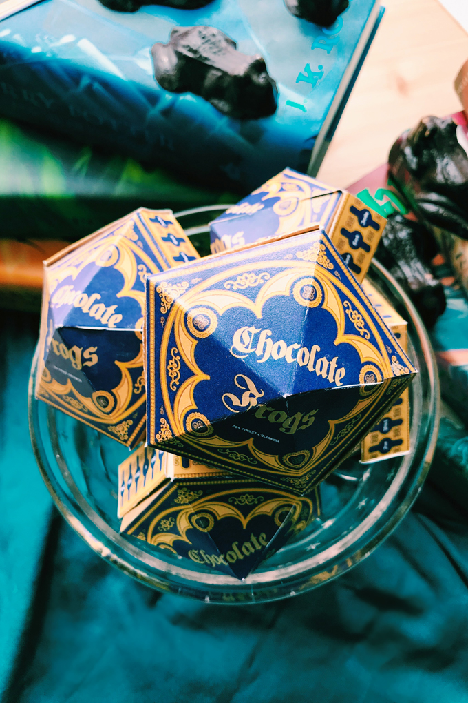 a glass bowl of chocolate frog boxes