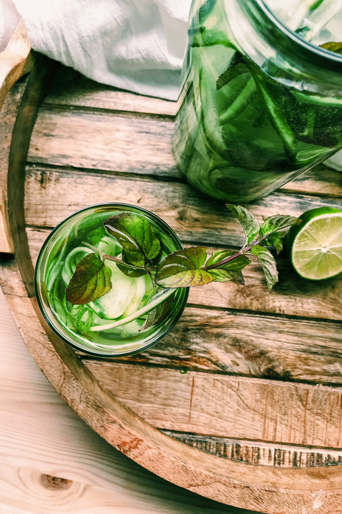 cucumber mint water on a wooden surface with lime