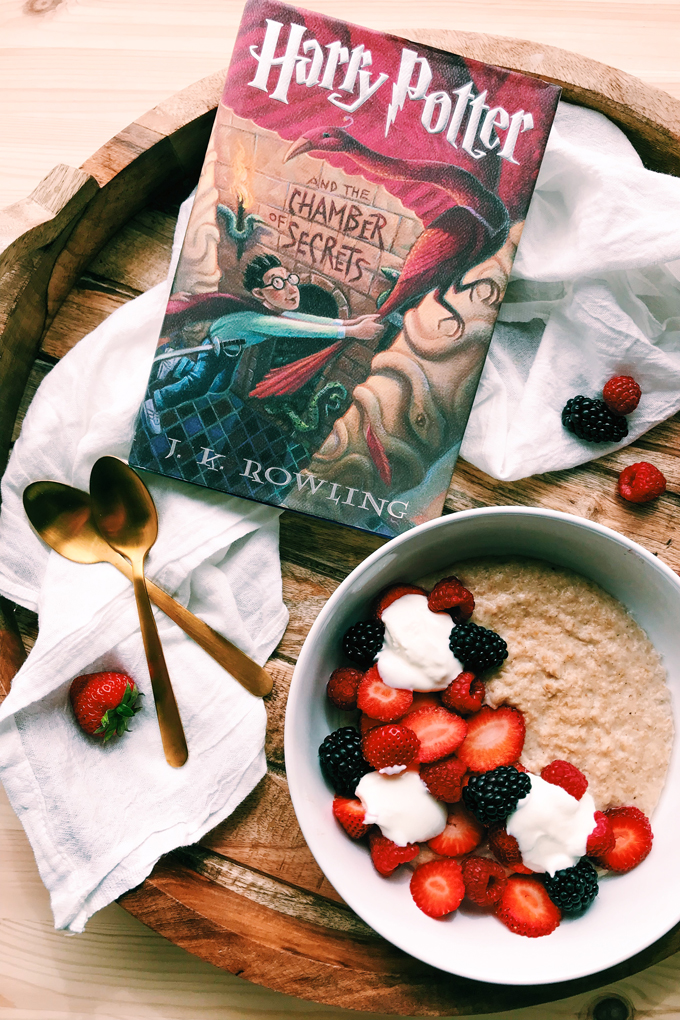 Harry Potter and the Chamber of Secrets book next to a bowl of Scottish Oat Porridge with fruit and yogurt