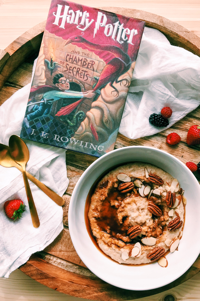 Harry Potter and the Chamber of Secrets book next to a white bowl of Scottish Oat Porridge with nuts and coconut sugar