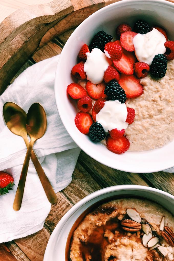 closeup of strawberries, blackberries, raspberries, yogurt on Scottish Porridge, gold spoons
