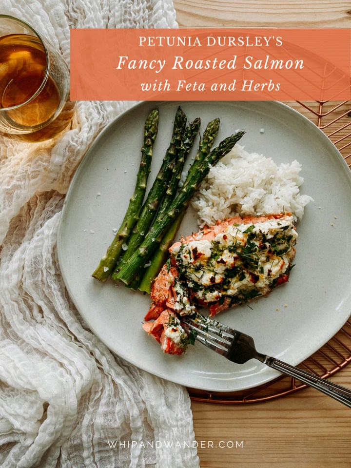 a fork cutting through a piece of salmon on a white plate with rice and asparagus, a glass of white wine is resting on a white cloth next to the plate