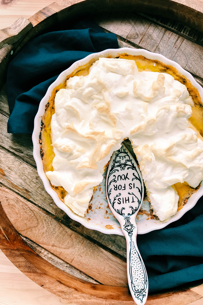 petunia dursley's lemon meringue pie with a slice taken out