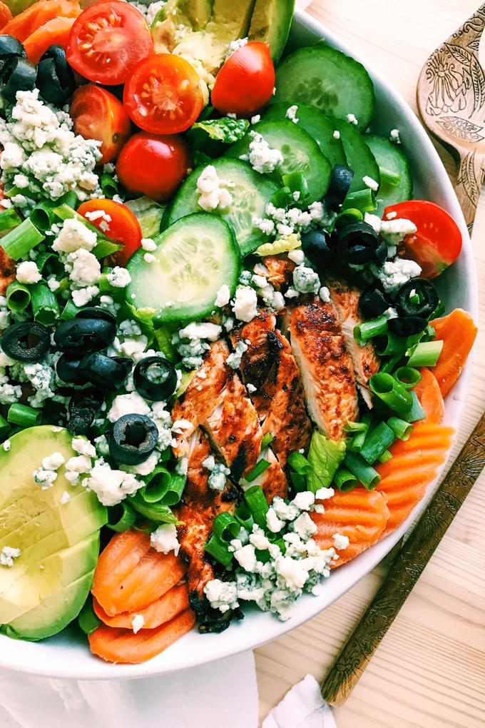 bbq chicken, carrots, avocado, cucumber, tomatoes, on salad