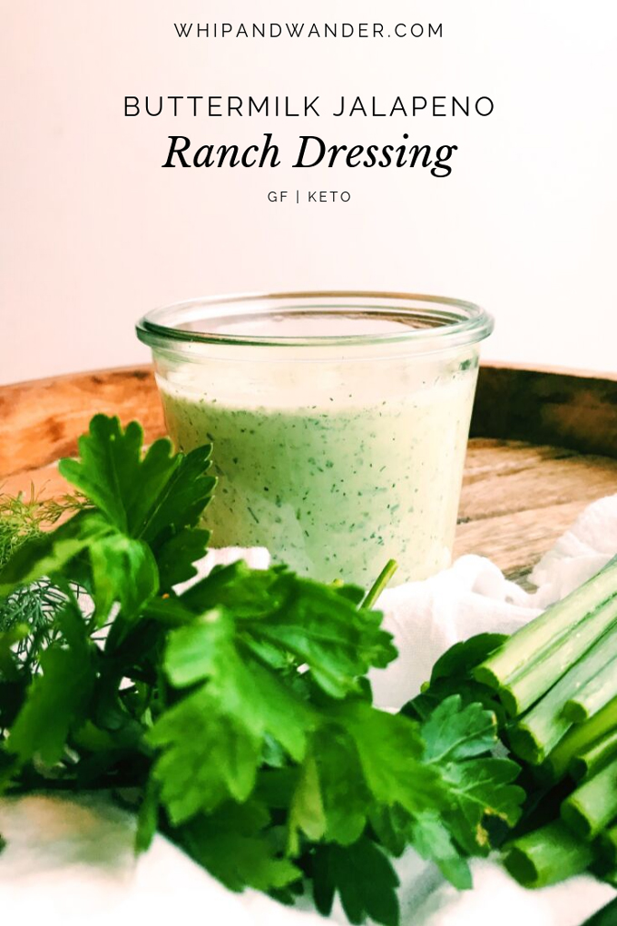 a jar of buttermilk jalapeno ranch dressing with herbs