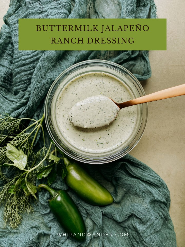 a green cloth with a jar of Buttermilk Jalapeno Ranch Dressing resting on top