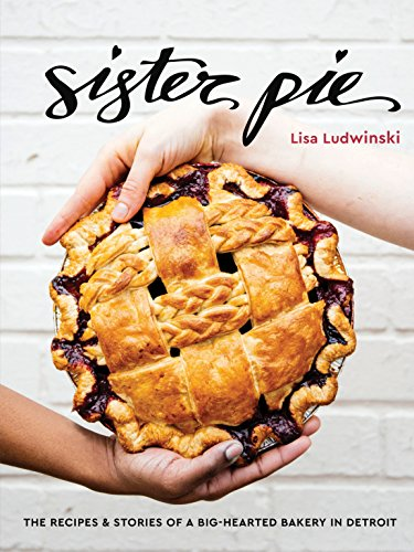 two hands holding a pie