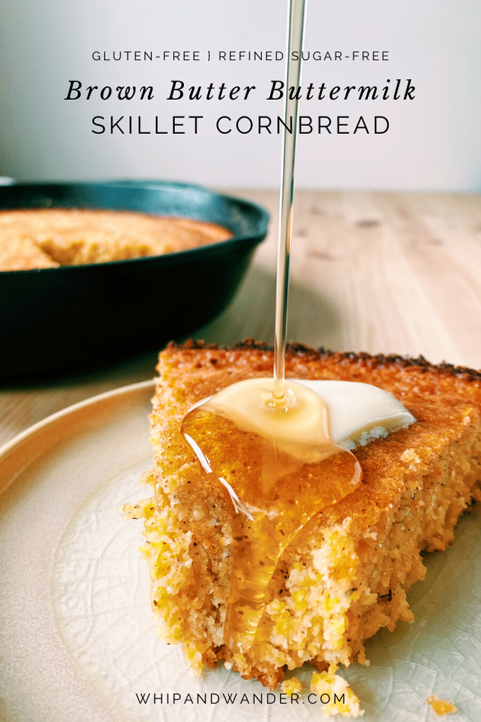 a drizzle of honey dripping on to a piece of Brown Butter Buttermilk Skillet Cornbread resting on a beige plate