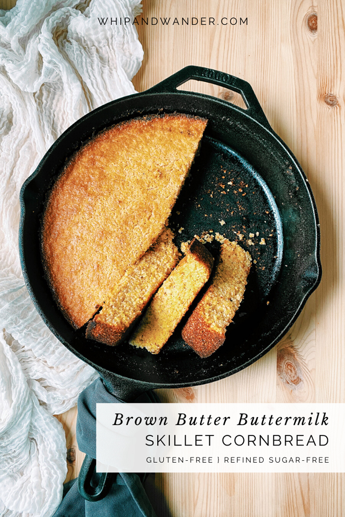 a Brown Butter Buttermilk Skillet Cornbread with several slices removed and stacked on their sides in the pan resting on a white towel