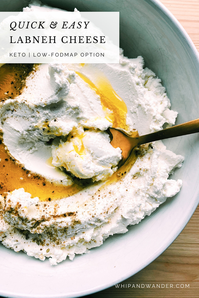 a gold spoon resting in a dish of olive oil drizzled on top of labneh yogurt with za'atar spices sprinkled on top