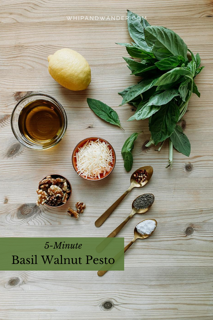 pinch bowls and spoons containing ingredients for basil walnut pesto resting on a wooden table