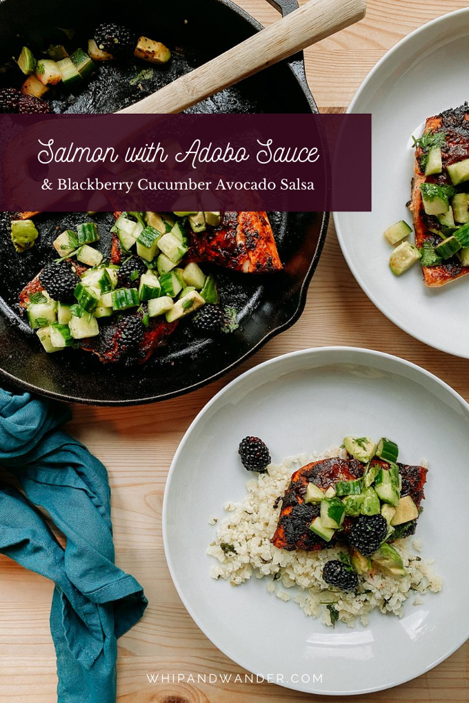 blackberry, avocado, cucumber salsa on top of salmon in two white bowls and a cast iron pan resting on a wooden surface with a blue towel