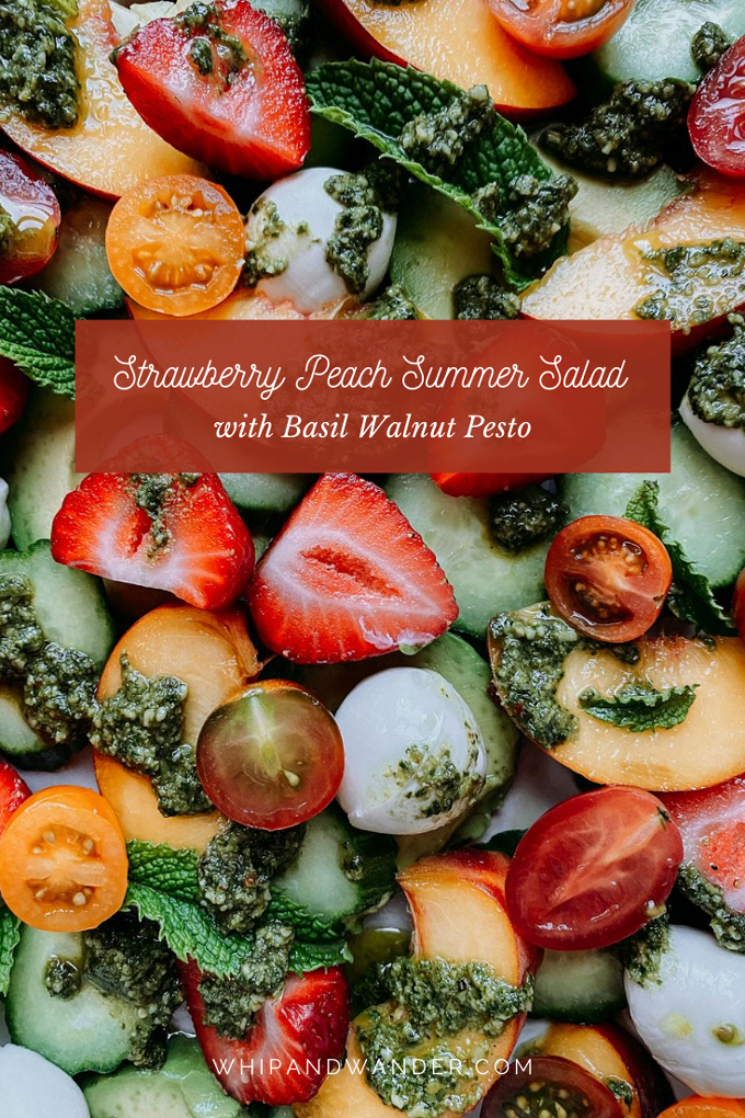 a summer salad of strawberries, peaches, cucumbers, avocado and cheese with pesto and mint on top