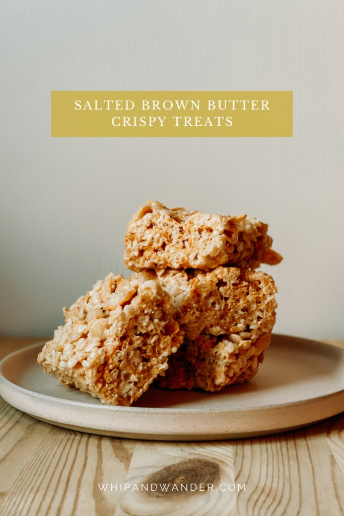 Salted Brown Butter Crispy Treats stacked on a dish resting on a wooden surface