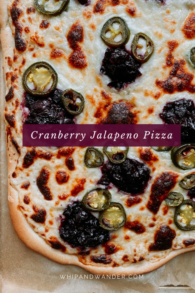 a white pizza with cranberry sauce and jalapenos