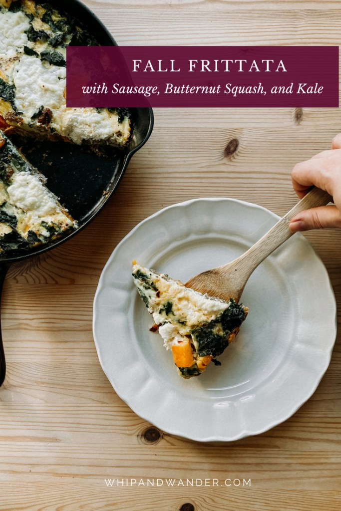 a hand that is placing a slice of Fall Frittata with Sausage, Butternut Squash, and Kale onto a white plate on a wooden table